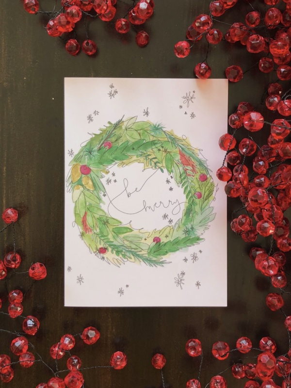 "greeting card with the words ""be merry"" written inside a greenery wreath"